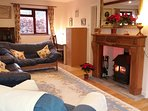 Large lounge with woodburner, widescreen tv, Sky+, wifi, underfloor heating etc.