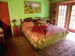 The master bedroom is decorated with antiques. Beds are high end hotel quality.