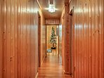 Knotty pine lines the walls of the hallways.