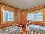 Talk into the late hours of the night with your roommate before drifting off to sleep in the Base Camp room's...