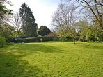 A view from the bottom of the garden towards the cottage.
