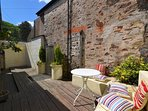 The sunny rear courtyard, great for al fresco dining.