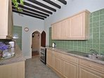 The fully equipped kitchen, with further facilities in a seperate utility room