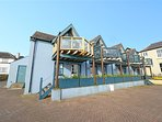 Stunning sea and harbour views from balcony and just a stones throw to sandy beach.