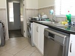 Scullery with double sink, dishwasher, washing machine and tumble dryer