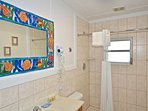 Full bathroom offers a step in shower, storage space and a hair dryer, just for you