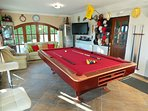 Games room with large HD flat screen TV with satellite multi language channels, seating for 7 guests