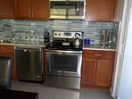 Newly remodeled kitchen with stainless steel stove/oven, microwave and dishwasher