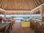 Dining area, Living area and Bar under this beautiful palapa