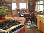 Chef's kitchen. 2 convection ovens, handcrafted copper sink. Dining room and sunroom bistro seating.