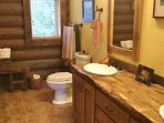 Master Bath. There are custom counter-tops from reclaimed bridge timbers throughout the cabin...