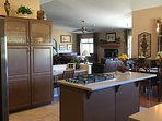 Open concept kitchen w/ large center island, gas cook top and plenty of storage