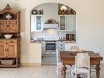 LMG Villas: upper level dining room and kitchen