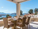 LMG Villas: upper level terrace and dining area with sea view