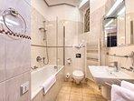 Bright bathroom with bathtub