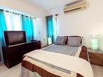 Master bedroom with en-suite bathroom, TV and AC