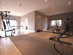 Onsite indoor gym with treadmill, spinbike, vibra machine, free weights, row and ski-ing machine..