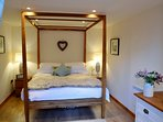 The king-size oak four-poster - we like to spoil our guests!