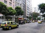 The avenue where the apartment is located and Its building in the middle of the pic.