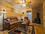 Lower level den with wood stove.