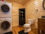 Half bath with washer and dryer on lower level.