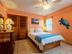 Bedroom with queen bed! Warm oranges accentuate the tropical feel of the island and Sunset Beach!