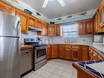 Huge fully equipped kitchen with amenities such as dishwasher, toaster, coffee maker, etc!