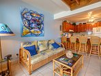 Living area with fantastic local artwork and kitchen counter beyond!