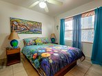 Second bedroom with queen sized bed. The colors in this unit are some of the best in the complex!