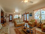 Bright and cheery living area! French doors on right of photo lead to the balcony overlooking ocean!