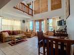 Beautiful high ceilinged great room! Notice loft area above. Two full span balconies facing ocean!