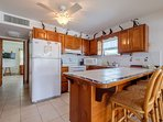 Kitchen counter with fully equipped kitchen! Bedroom one is in the back down the hall.