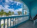 Beautiful waving palms in ocean breeze from second floor balcony!