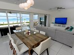 Great dining table and 75' smart TV