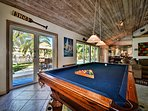 Billiards area has a wonderful view of the beautiful pool.