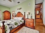 Master bedroom has king size bed, stairs lead to bunk bed nook.