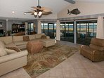 Living room with sectional sofa with chaise lounge, side chair, ceiling fan