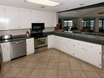 Kitchen with long counter and stainless steel appliances