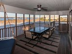 Screened porch with large dining table for 6 overlooking lagoon