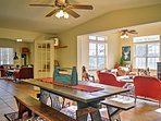 The large dining table will accommodate your group as you enjoy a delicious feast.