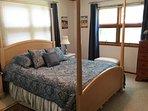 Masterbedroom with Queen bed and half bathroom.