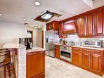 Gourmet kitchen with stainless steel appliances (microwave, full size stove, dishwasher, fridge), granite counters...