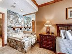 Master bedroom suite with en suite bath and large Jacuzzi jetted stone tub; mountain decor & top quality finishings.