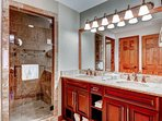 Master suite bathroom with his and hers vanity, granite countertops, custom rain/steam shower with walk in closet.