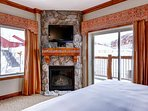 Guest bedroom (2) with king size bed, stone floor to ceiling fireplace with western and southern facing views.