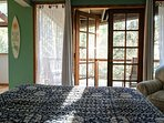 Downstairs queen bedroom with nice deck looking into the woods