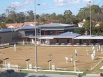 Adjacent bowling greens, and Helensvale Club with entertainment