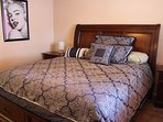 Master bedroom and California King bed.