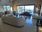 65m2 huge lounge w\patio doors to 30m2 terrace, spectacular lake views & electric sun shade.
