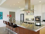 Gourmet kitchen with large island bench and all modern appliances